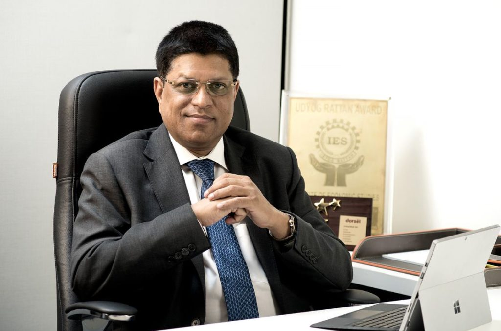 Portrait of Rajesh Bansal, Managing Director of Dorset Group.